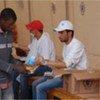 Distribution de nourriture par le PAM à Ras Jedir, à la frontière entre la Tunisie et la Libye.