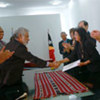 Prime Minister Xanana Gusmao and SRSG Ameerah Haq  exchange letters for transferring  policing responsibilities