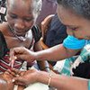 A young baby receives polio vaccine during drive to eradicate disease