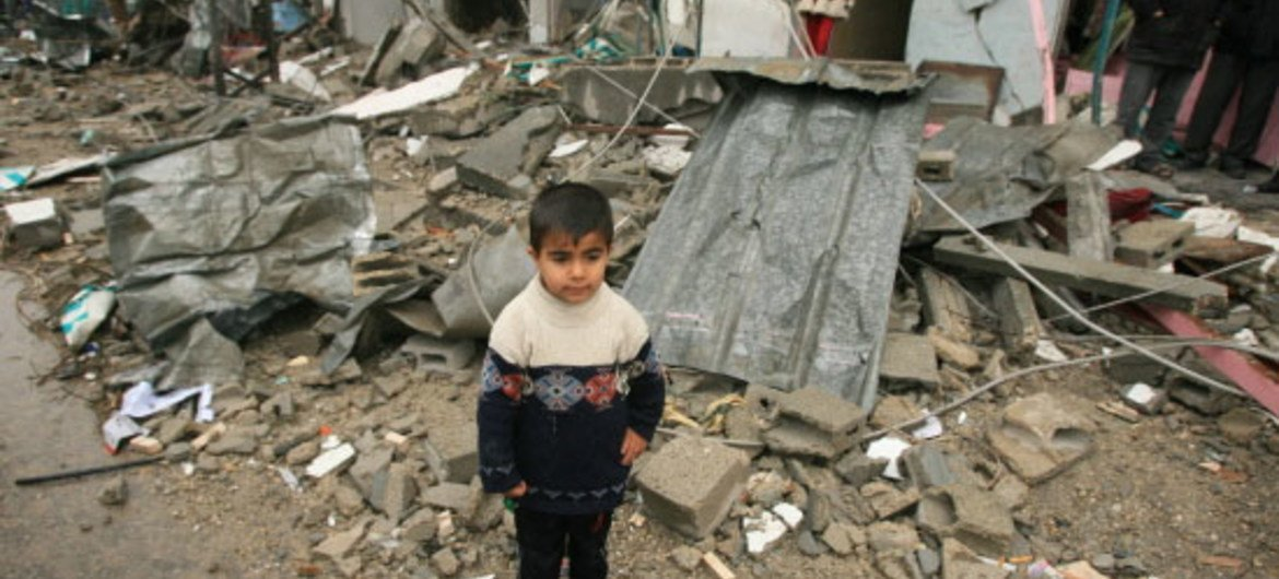 A Palestinian boy amidst the debris of a destroyed house in Gaza City [File Photo]