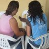 A UNHCR staff member (right) listens to the story of a commercial sex worker in Esmeraldas, Ecuador