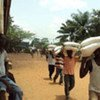 Ivorians collect food at distribution centre in the west of the country