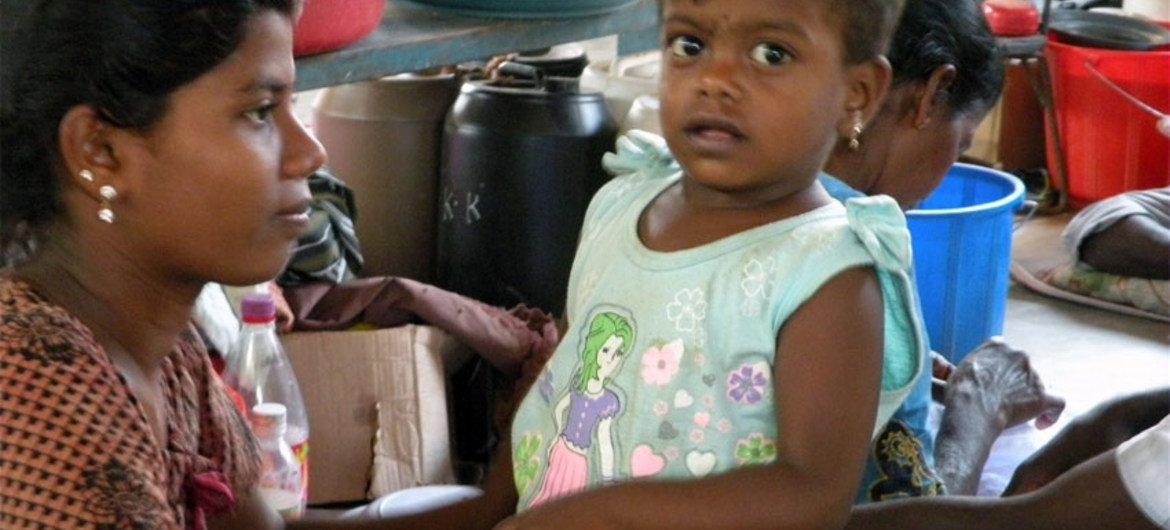 A young girl and her mother at a displaced persons camp in Vavuniya, Sri Lanka (2009).