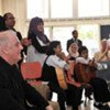 World-renowned conductor Daniel Barenboim (left) with young musicians on his first visit to the Gaza Strip