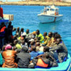 A boat carrying sub-Saharan African migrant workers arrives in Lampedusa from Tripoli, Libya.