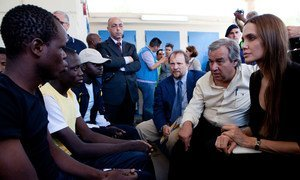 Refugees chief António Guterres and Angelina Jolie (R) talk with asylum-seekers on the Italian island of Lampedusa. UNHCR/J. Tanner