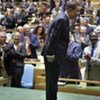 Secretary-General Ban Ki-moon bows as delegates applaud his appointment to a second term