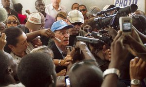 SRSG Edmond Mulet speaks with the press at a voting centre, during the final round of Haiti's national elections in March 2011