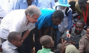 UNHCR chief António Guterres (left, crouching) chats with Somali refugees in Ifo camp at Dadaab, northern Kenya