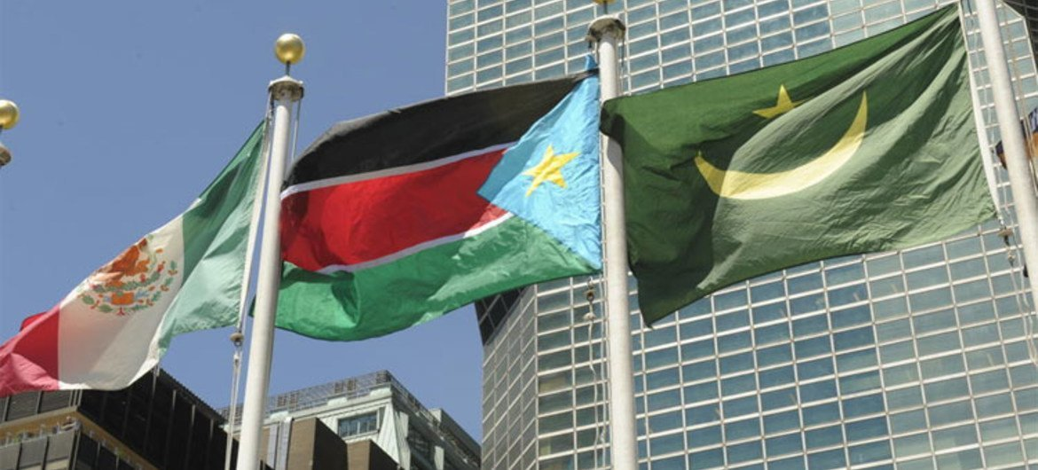 South Sudan's national flag (centre) flies at UN Headquarters following its admission as the 193rd Member State. UN/E. Schneider