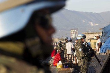 MINUSTAH peacekeepers stand guard in Cité Soleil