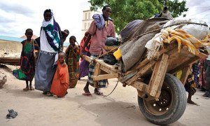 A family arrives in Galkayo after fleeing the drought in Buale, Somalia