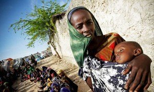 A Somali woman and her severely malnourished child wait for medical assistance from the African Union Mission in Somalia
