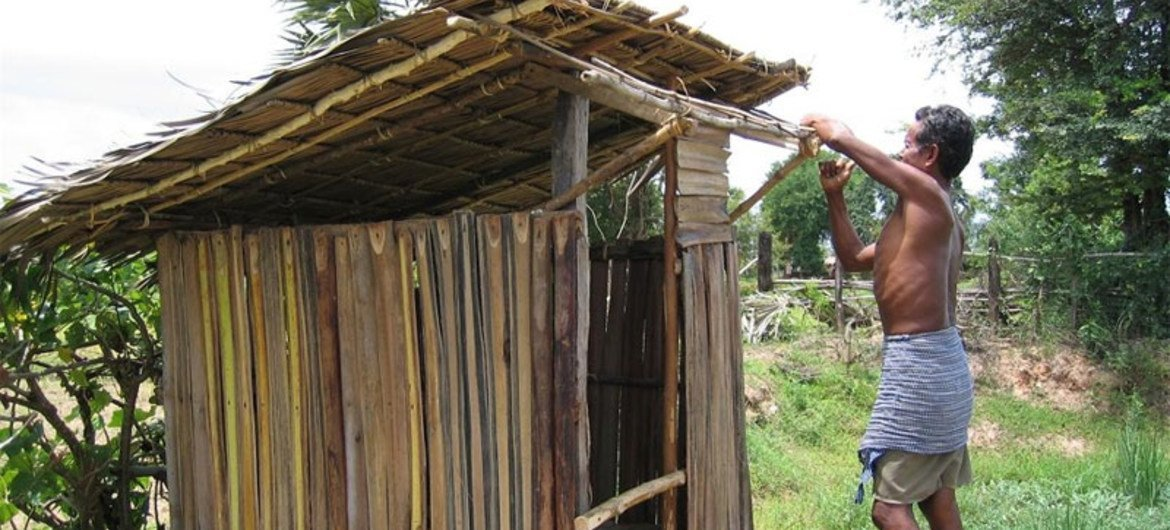 Constructing a toilet in Cambodia.