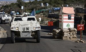 UNIFIL armoured vehicles pass through a Lebanese Armed Forces checkpoint near Ghanduriya.