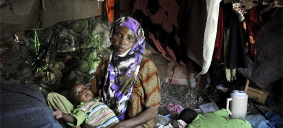 A Somali mother and child find safety after fleeing from their home area earlier this year