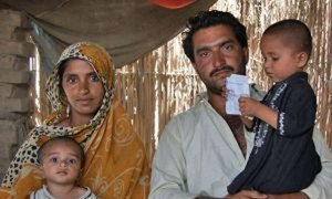 A year after monsoon floods in Pakistan, families like this one who lost their property are getting back on their feet