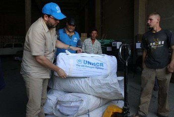 UNHCR staff prepare to distribute aid to those displaced by the earthquake