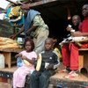 Members of the Pepidi family take a lunch break during their long trip home to the Republic of Congo from Gabon