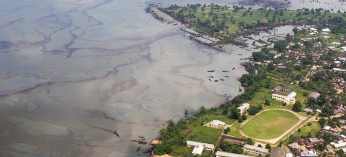 An aerial view of Ogoniland shows oil floating on the water's surface.