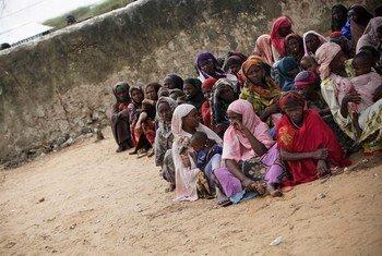 Internally Displaced Somalis wait for food distribution at the Badbado camp