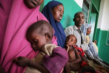 Parents wait with their malnourished and dehydrated children in a corridor at Banadir Hospital in the Somali capital Mogadishu