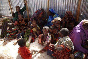 Somali refugee women and children wait to be registered at a transit centre in Dollo Ado.