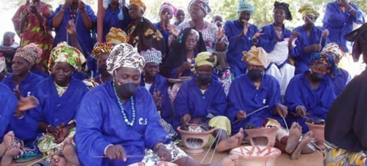Women artisans in Mali making bracelets for sale to tourists using recycled plastic materials