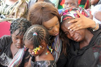 Mourners at a memorial service in honour of the victims of the 26 August 2011 attack on the UN compound in Abuja, Nigeria.
