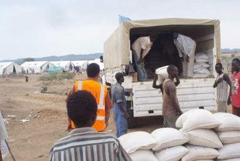 WFP food assistance being offloaded from a truck at a distribution site in the South Kordofan capital Kadugli.