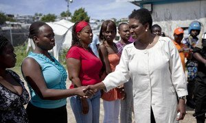 Under-Secretary-General for Humanitarian Affairs Valerie Amos (right) meets residents of Accra camp in Haiti