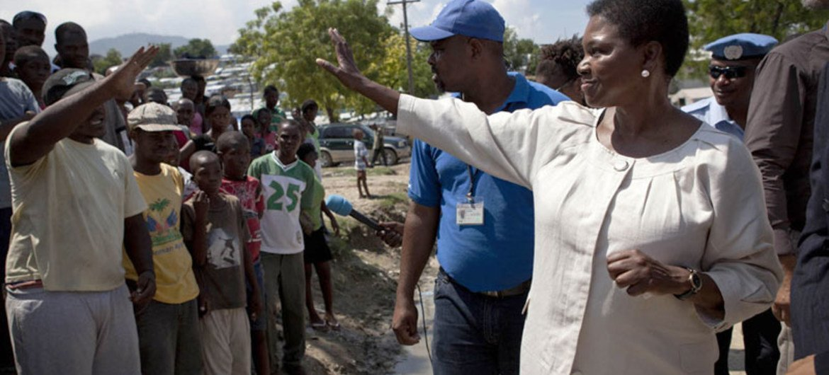Humanitarian chief Valerie Amos (right) being greeted by residents of the Accra Camp in Haiti during her visit in September 2011