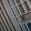 les barreaux d'une cellule de prison.