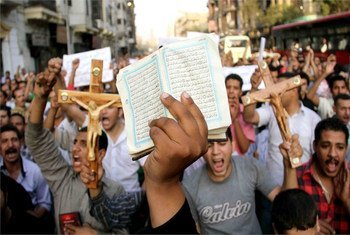 Christians and Muslims demonstrate in Cairo, Egypt, against the killing of Christian civilians in clashes with military policemen