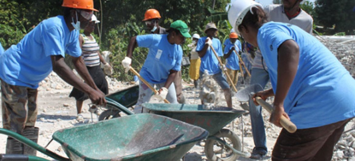 Haitians — employed by UNDP-coordinated initiatives — clear debris that will be recycled or disposed of for post-quake reconstruction