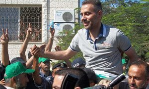 A Palestinian released in an exchange of prisoners by Israel and Hamas reaches welcoming festivities in Gaza City on 18 October 2011.