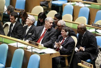 The Cuban delegation waits as the General Assembly votes on resolution calling for an end to the US embargo