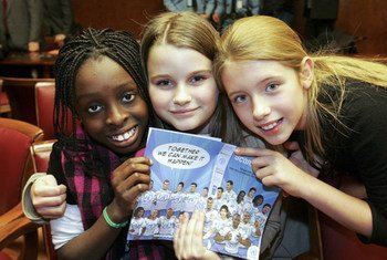 """Children enjoying the launch of the new comic book """"Score the Goals"""" at the United Nations in Geneva"""