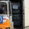 A forklift truck loads up with aid for Turkey at UNHCR emergency aid warehouse in Dubai