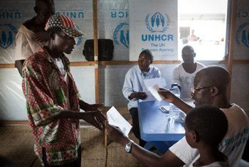 UNHCR staff help prepare Angolan refugees for their return home from the Democratic Republic of the Congo.