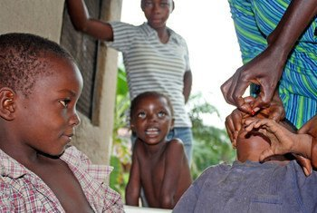 Oral polio vaccine being administered.