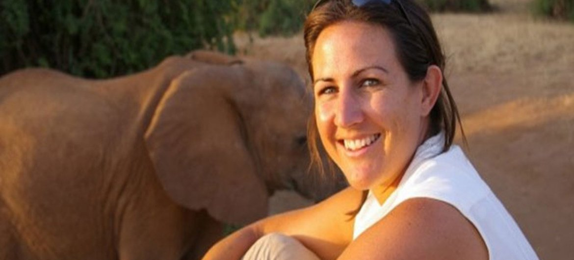 British biologist, Dr. Lucy E. King and an elephant