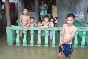 Heavy rains in the Philippines in June 2011 left scores of homes like this one in Cortabato City, Mindanao, inundated with water