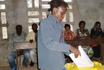 In Kisangani, DRC, a woman casts her ballot at a polling centre during national elections.