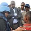 Special Representative for Children and Armed Conflict Radhika Coomaraswamy (left) speaks with child surrendered from Al-Shabaab in Mogadishu, Somalia.