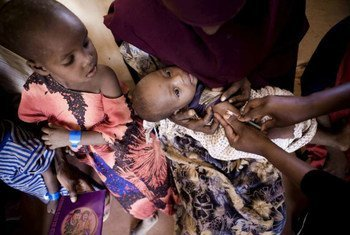 A young Somali refugee receives an injection at a reception centre in Kenya's sprawling Dadaab complex