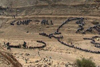صورة جوية لحمامة السلام لبيكاسو التي شيدتها الفنان المشهور عالميا، جون كويغلي، في جبل الأربعين أو جبل التجربة بأريحا.
