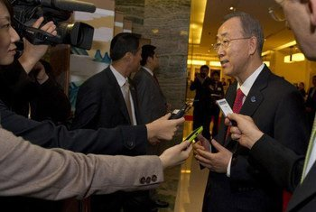 Secretary-General Ban Ki-moon speaks to reporters on arrival in Busan, Republic of Korea, to address the Fourth High-Level Forum on Aid Effectiveness