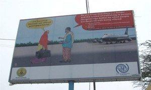 A human trafficking awareness billboard.