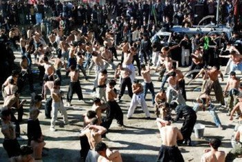 Afghan men perform self-flagellation during the ten-day Shiite mourning period of Ashura